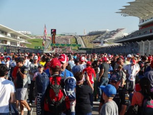 Fans fill the track during the post-race walk.  [Paul Gohde Photo]