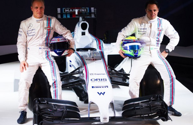 Valterri Bottas (left) and Felipe Massa sit next to the new Williams Martini Racing livery Thursday evening in London. [Photo by Getty Images]