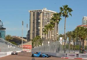 Swaying palm trees with cars on track.  [Joe Jennings Photo]