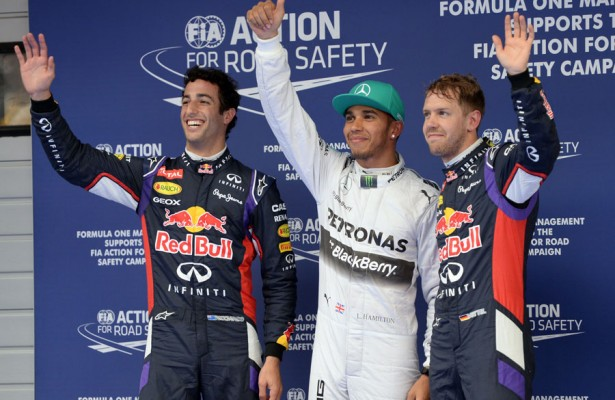 Lewis Hamilton, flanked by Daniel Ricciardo (left) and Sebastian Vettel (right) pose for photographers after Saturday's qualifying session for the Grand Prix of China. For Hamilton, it was his third pole victory in four races.  [Photo by Getty Images]