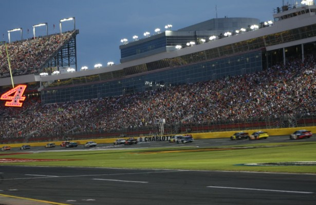 A large crowd fills the grandstands at the Charlotte Motor Speedway.  [Everet Kamikawa photo]