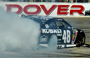 Jimmie Johnson, driver of the #48 Lowe's/Kobalt Tools Chevrolet, celebrates with a burnout after winning the NASCAR Sprint Cup Series FedEx 400 Benefiting Autism Speaks at Dover International Speedway.  [Credit: Rainier Ehrhardt/Getty Images]