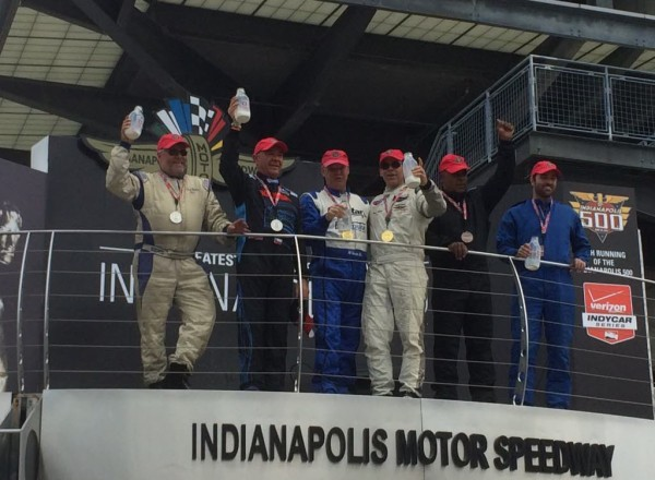 The winning podium of Al Unser, Jr., Eliseo Salazar and Willy T. Ribbs pose with co- drivers at Indianapolis Motor Speedway.  [Steve Zautke photo]