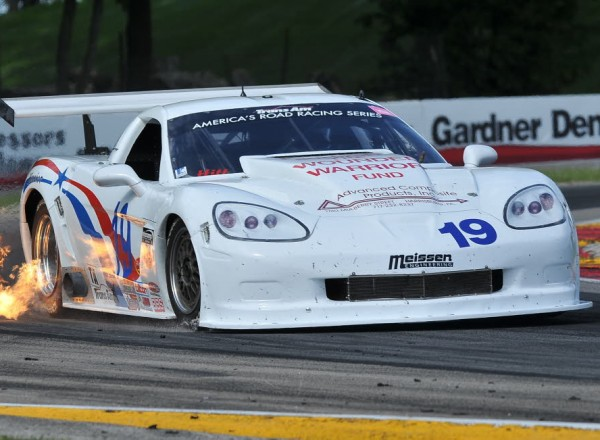 Trans Am racer Kerry Hitt lights it up in his Chevrolet Corvette.  [John Wiedemann Photo]