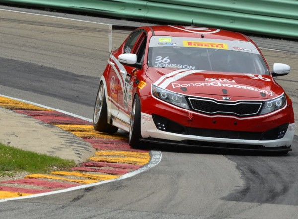 Nic Jonsson in Canada Corner at Road America in his Kia Optima.  [John Wiedemann Photo]