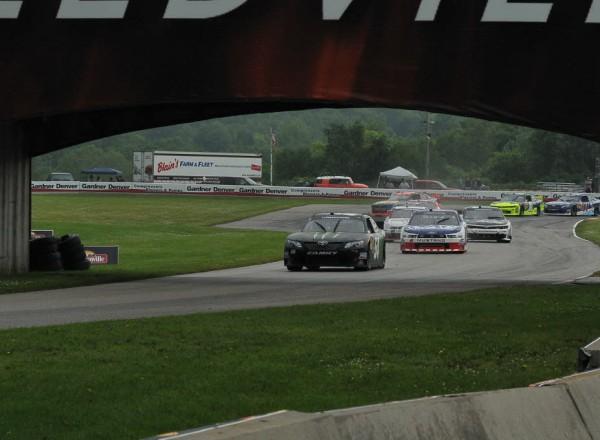 Sam Hornish Jr leads following  a restart with the entire field running rain tires.  [John Wiedemann Photo]