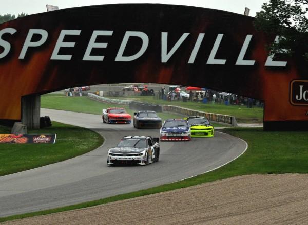 Brian Scott leads a pack of cars under the Johnsonville/Speedville bridge.  [John Wiedemann Photo]