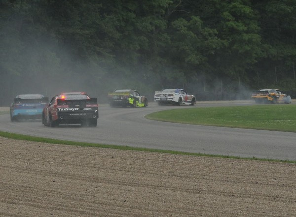 Brendan Gaughan trails tire smoke after right front damage to his Chevrolet.  [John Wiedemann Photo]