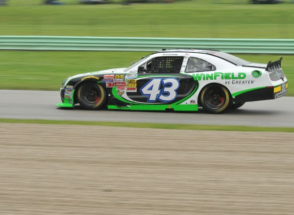 Dakoda Armstrong speeds through turn nine in wet conditions.  [John Wiedemann Photo]