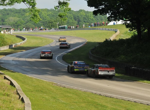Brendan Gaughan leads Kevin O'Connell and Alex Tagliani up into turn thirteen on the final lap at Road America.  [John Wiedemann Photo]