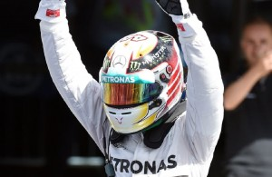 Lewis Hamilton celebrates his fifth win of the season Sunday at the British Grand Prix . It is his first victory at this track since 2008, and puts him four points behind teammate and series leader Nico Rosberg.  [Photo courtesy of ESPN F1.]