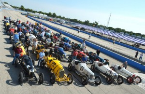 Car owners gather with their cars for the traditional pre-event group photo.  [Russ Lake photo]