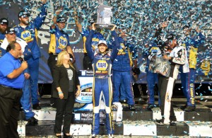 Chase Elliott celebrates his EnjoyIllinois.com 300 victory at Chicagoland Speedway.  [Russ Lake Photo]
