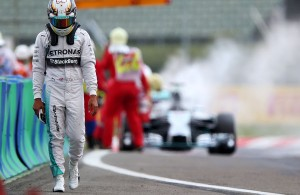 Lewis Hamilton walks back to the pits after encountering his second retirement in qualifying Saturday for the Hungarian Grand Prix at the Hungaroring. The Briton will start 21st.   [Photo by Sutton Images]