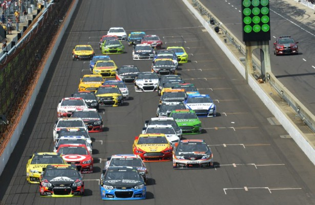 Kasey Kahne leads the field on the final restart of the Brickyard 400.  [Russ Lake Photo]