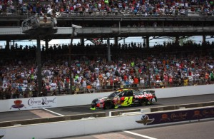 Jeff Gordon crosses the bricks, picking up a historic fifth Brickyard 400 victory.  [Mark Walczak Photo]