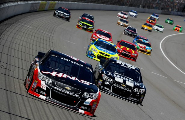 Kurt Busch leads Jimmie Johnson and a pack of cars during the Quicken Loans 400 at Michigan International Speedway.  [Credit: Brian Lawdermilk/NASCAR via Getty Images]