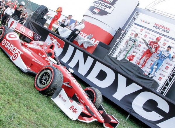 Celebration at the Honda Indy 200 with Scott Dixon's winning car in the foreground.  [Andy Clary Photo]