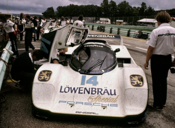 Al Holbert behind the wheel of the Lowenbrau Porsche 962 in the pits at Road America in 1985.  [Photo by Jack Webster]