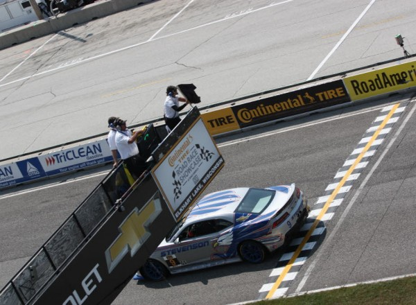 Andy Lally, while leading the race, gets the black flag for pit-stop violations.  [Mark Walczak Photo]