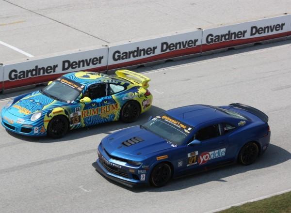 Lawson Aschenbach passes Matt Plumb on the Road America frontstretch.  [Mark Walczak Photo]