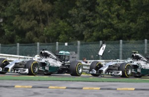 Nico Rosberg (right) strikes teammate Lewis Hamilton on lap two during Sunday's Belgian Grand Prix at Spa, Belgium. Daniel Ricciardo went on to win his third grand prix of the season.  [Photo by Getty Images]