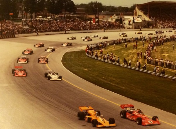 The field is ready for the 1974 USAC Rex Mays 150, as A.J. Foyt #14 and Johnny Rutherford #3 pace the field.  [Armin Krueger photo courtesy of Greenfield Gallery & Ralph Hibbard, Jr.]