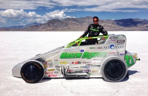 "Damion Gardner poses with the ""Green Demon"", which went 211.5884 MPH at the Bonneville Salt Flats.  [photo credit to Surf N' Sprint]"