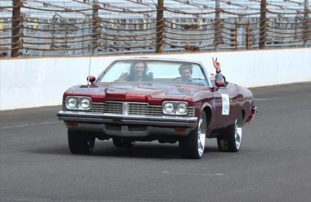 Local Indiana teen JD takes a ride in his restored 1974 Pontiac Grand Ville Convertible via the Make A Wish Foundation at the Indianapolis Motor Speedway with JR Hildebrand -- Photo by: Chris Owens