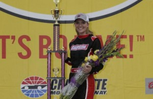 Ashley Deihl Stremme poses with her trophy in Victory Circle following her win in last year's Better Half Dash at Charlotte Motor Speedway. (Credit: CMS Photo/HHP)