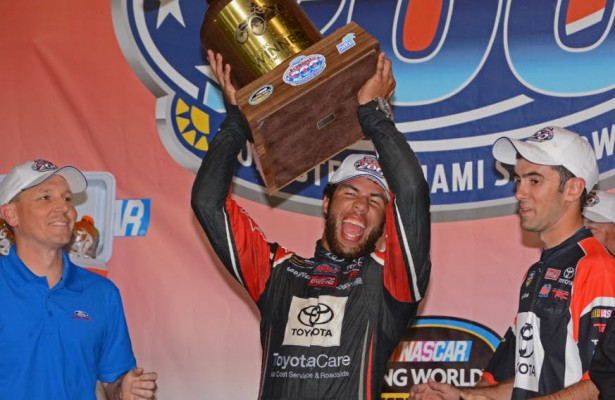 Ford EcoBoost 200 winner Darrell Wallace lets out a victory cheer upon receiving winner's trophy.  [Joe Jennings Photo]