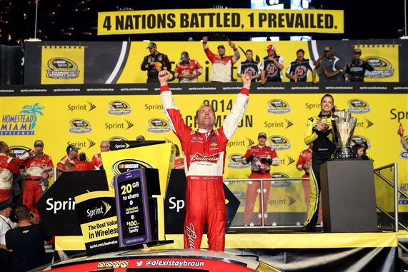 Kevin Harvick celebrates in victory lane after winning the race and the NASCAR Sprint Cup Series championship at Homestead-Miami Speedway. [Chris Graythen/Getty Images]