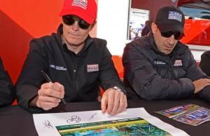 Scott Dixon and teammate Tony Kanaan sign autographs ahead of Rolex24.   [Joe Jennings Photo]