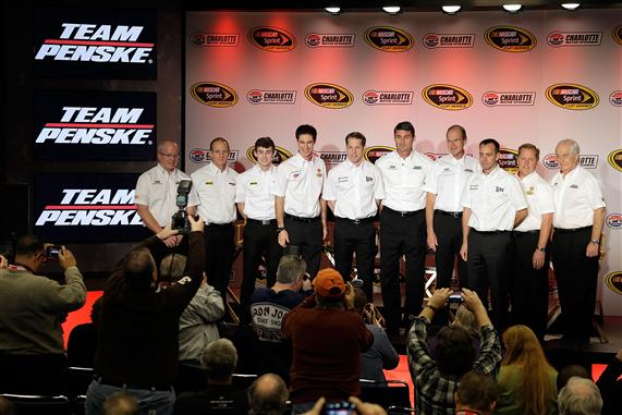 Team Penske drivers and officials pose for photographers during day 3 of the Charlotte Motor Speedway NASCAR Media Tour at the Charlotte Convention Center.  [Credit: Bob Leverone/NASCAR via Getty Images]