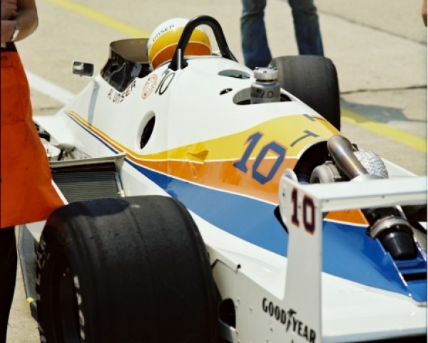 The unique Longhorn LR03-Cosworth pictured in pit lane in 1982.  The ungainly ground effects car did carry Al Unser to a fifth place finish, three-laps down to the winner.  Courtesy of the Indianapolis Motor Speedway