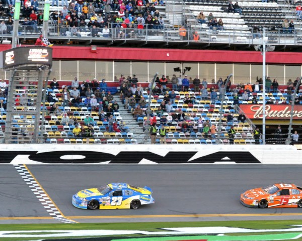Grant Enfinger races Daniel Suarez to the checkers to win the Lucas Oil 200 at Daytona.  [Russ Lake Photo]