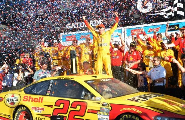 Joey Logano jumps out of his ride and celebrates his Daytona 500 victory.  [Russ Lake Photo]