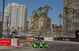 With high-rise buildings as the backdrop, Sebastien Bourdais shown in action in turn 11. [Joe Jennings Photo]