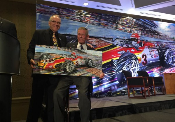 Bobby Unser getting Giclee print from Randy Owens at the RRDC dinner where he was honored.  [Eddie LePine Photo]