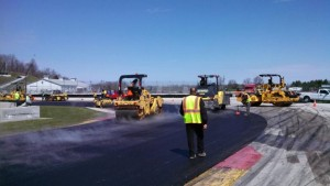New asphalt going down in Turn 14 at Road America.