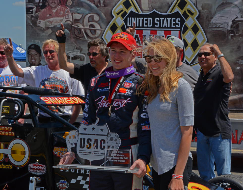 Joined by wife Allison and the winning team, Tanner Swanson enjoys victory lane. [Joe Jennings Photo]