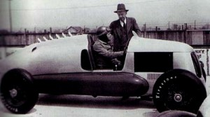 Designer and builder Harry Miller looks over his rear-engine Miller race car with driver, George Bailey.  [Photo courtesy of the Indianapolis Motor Speedway]