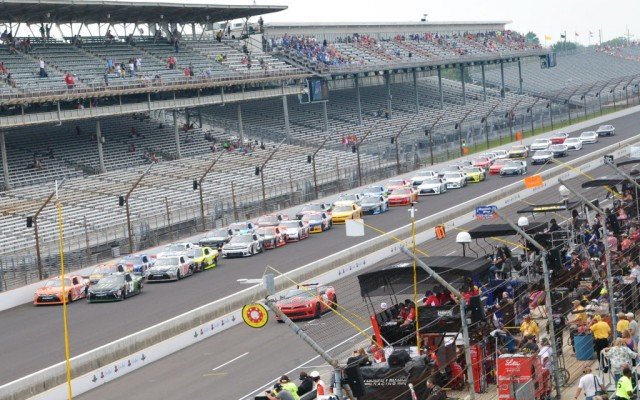 The field comes to the green for the Xfinity race at Indianapolis.  [Russ Lake Photo]