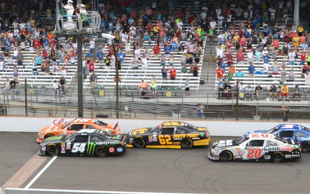 Kyle Busch and teammate Daniel Suarez lead at the start of the Lilly Diabetes 250.  [Russ Lake Photo]