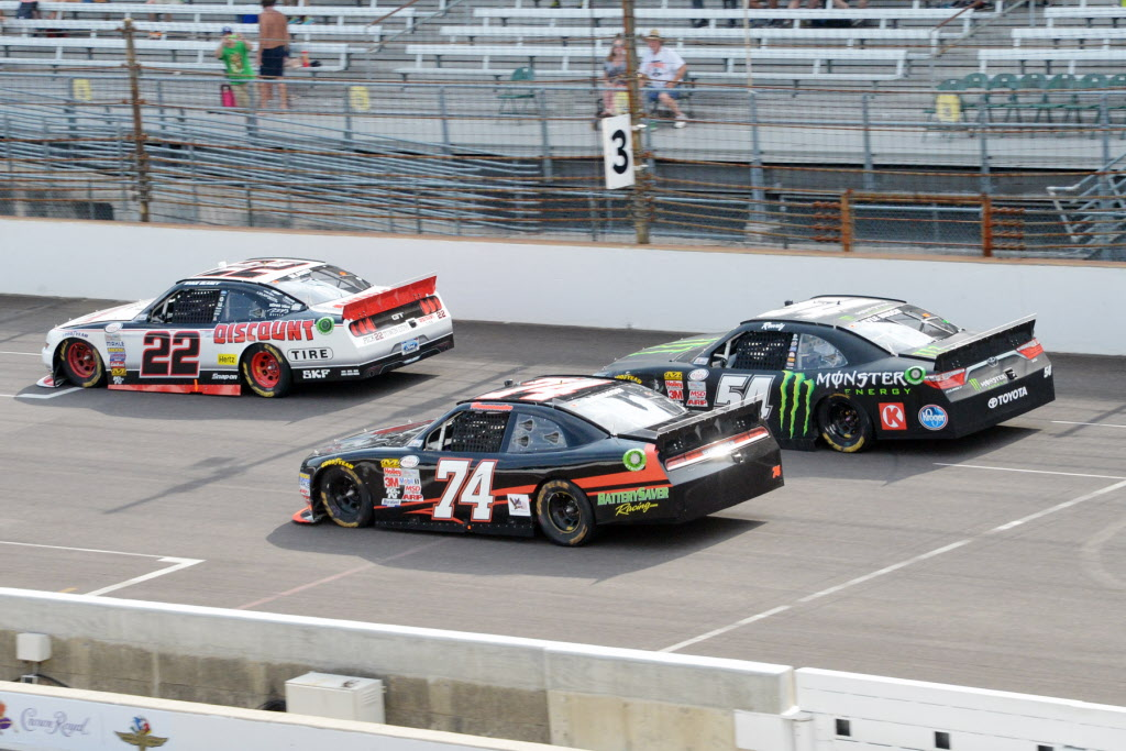 Ryan Blaney (22) is chased by Kyle Busch (54). [Russ Lake Photo]