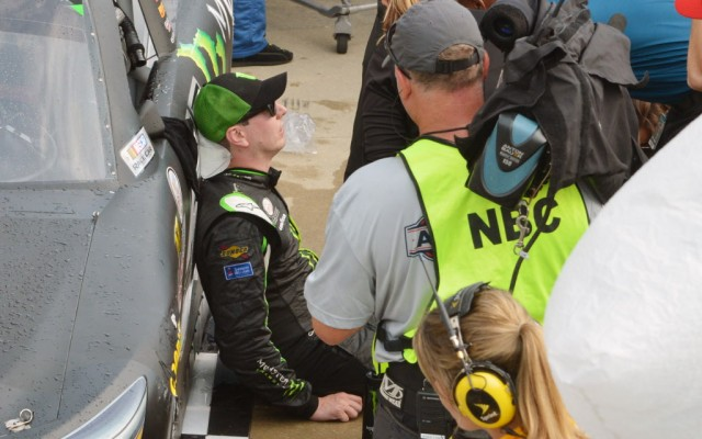 Kyle Busch rests after an exhausting win at Indianapolis.  [Russ Lake Photo]