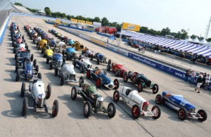 36 vintage Indy cars are lined up on the front straightaway for the 21st annual Harry Miller Club Vintage Indy Car Meet. 50 cars were on hand for the signature event on the vintage oval racing calendar. [Photo by Russ Lake]