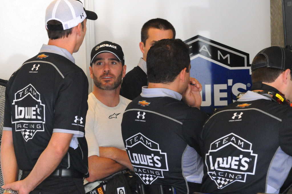 Jimmy Johnson, crew chief Chad Knaus and the team prepare for the Brickyard 400. [Father Dale Grubba Photo]