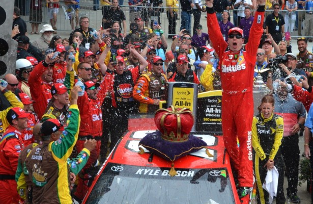 Kyle Busch celebrates his first NASCAR Sprint Cup Series victory at Indianapolis Motor Speedway. [Russ Lake Photo]