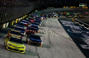 Matt Kenseth leads a pack of cars during the NASCAR Sprint Cup Series Irwin Tools Night Race at Bristol Motor Speedway. [Credit: Brian Lawdermilk/NASCAR via Getty Images]